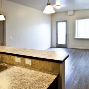 Kitchen overlooking the living room in available unit